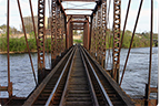 a photo of a railroad bridge